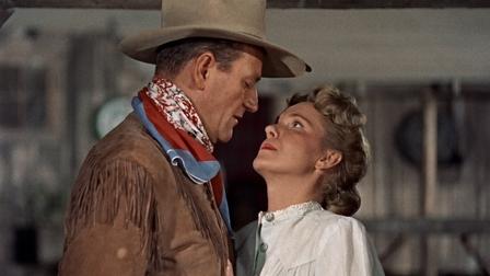 Um romance que brota entre o forasteiro e a esposa do rancheiro