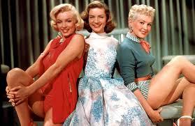 """Com Marilyn Monroe e Betty Grable em """"Como agarrar um milionário"""""""