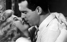 Barbara Stanwyck e Fred McMurray em Pacto de sangue.