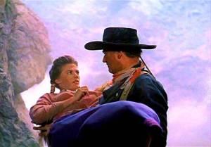 """John Wayne e Natalie Wood na obra prima de John Ford, """"Rastros de Ódios""""."""