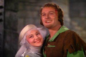 """Com Errol Flynn, em """"As aventuras de Robin Hood""""."""