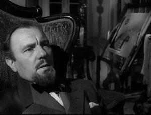 """O grande ator Ralf Richardson, como o médico frio de """"Tarde demais""""."""