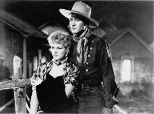 """""""No tempo das diligências"""" (1939), Claire Trevor e John Wayne."""